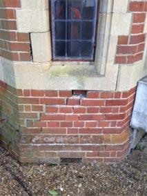 exterior cracks beneath window